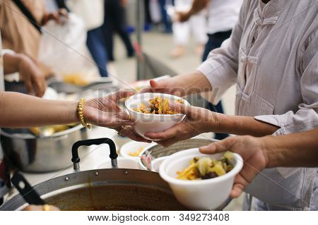 Help Serving Free Food To The Poor Needy : Concept Sharing Food With Homeless