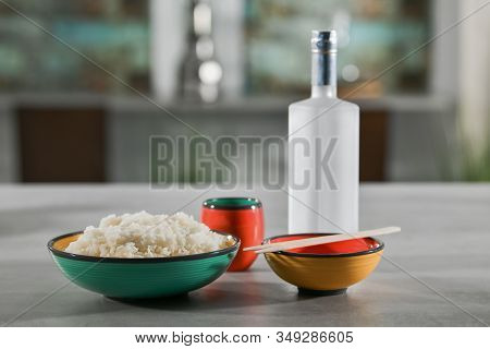 Close-up Of A Bowl Filled With White Rice, Another Bowl With Wooden Chopsticks On Top In Front Of A