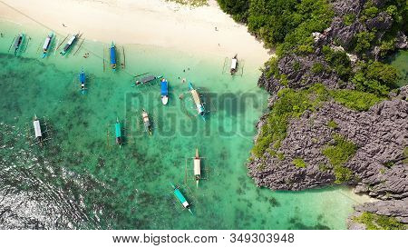 Sandy Beach With Tourists And Tropical Island By Atoll With Coral Reef, Top View. Lahos Island, Cara