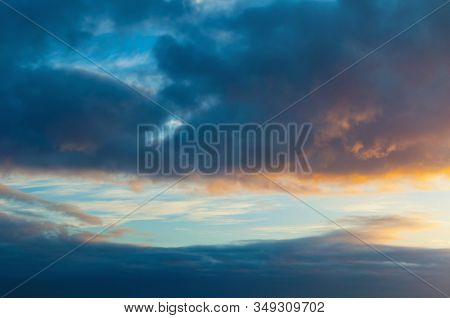 Dramatic blue sky background. Picturesque colorful clouds lit by sunlight. Vast sky landscape panoramic scene - colorful sky view