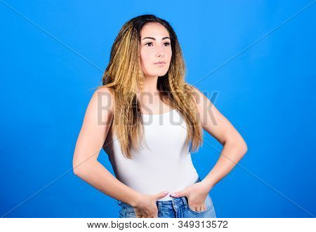 Voluminous Crimped Hair. Crimped Hairstyles. Woman Stylish Hairstyle On Blue Background. Hair Crimpi