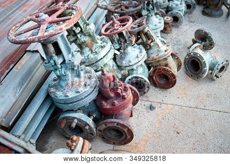 Old Valves Taps Shutoff Flaps Vents Of Chemical Production Dismantled. Concept Of Modernization And