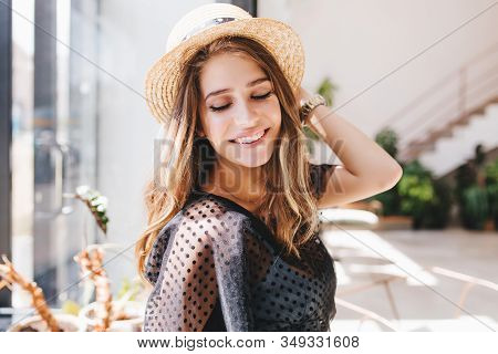 Lovely Fair-haired Girl With Big Happy Smile Posing In Light Room Enjoying Good Memories. Indoor Clo