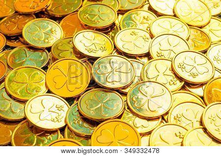 St Patrick's Day background. Golden coins with shamrock under soft sunshine, St Patrick's day concept. St Patricks day festive composition, St Patricks day card