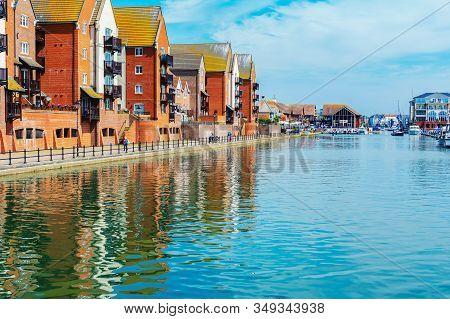 Eastbourne, East Sussex, Uk - May 23 : View Of Sovereign Harbour, Houses And Boats In Eastbourne In