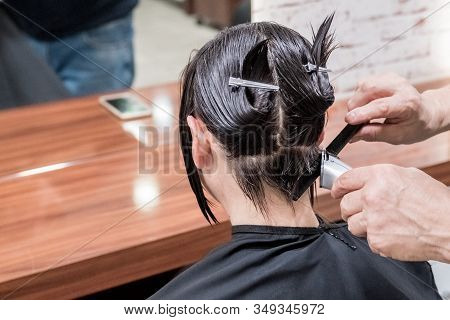 Brunette Woman Getting Haircut In Hairdressing Beauty Salon. Beauty Concept.