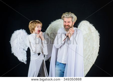 Little Cupid Boy And Father In White Clothes. Happy Father In Angel Costume With Little Son Angel. C