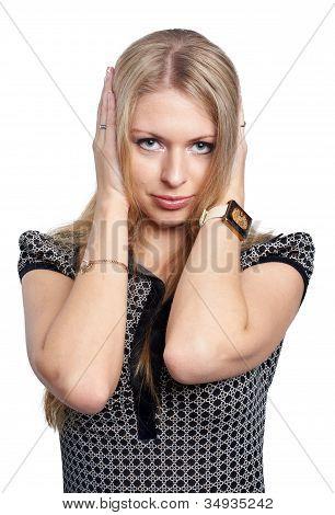 Pretty girl covering er ears