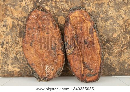 Group Of Two Whole Fresh Brown Cocoa Bean With Cocoa Butter Isolated On White Background