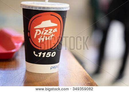 Samut Prakan, Thailand - February 6, 2020 : Paper Glass Of Pizza Hut Paper With Soft Drink Pepsi On