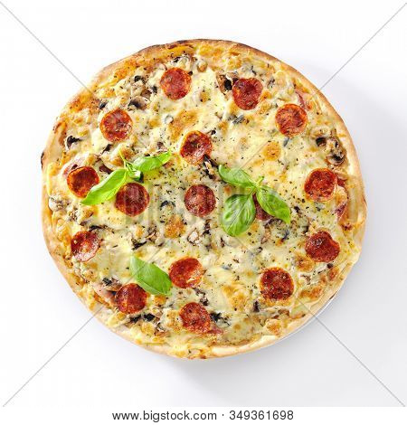 Traditional italian pepperoni pizza with mushrooms, salami, mozzarella cheese, fresh basil and tomatoes isolated. Delicious italy boletus flatbread cutout, hot tasty fast food topview