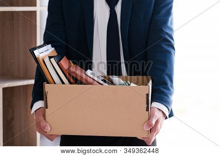 Businessmen Are Holding Resignation Document And Packing Personal Company On Brown Cardboard Box Cha