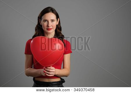 Beautyful Emotional Brunette Girl With Red Balloon