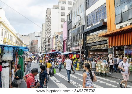 Sao Paulo Sp, Brazil - November 22, 2019: Popular Commerce At March 25 Street. People On The Streets