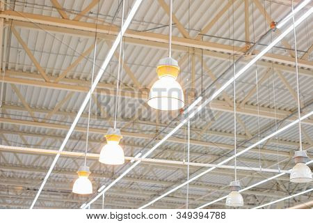 Ceiling With Bright Lamps In A Modern Warehouse. Image Of Bright Light, A Large Space For Trade, Sto
