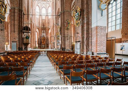 Riga, Latvia - July 1, 2016: Nave Of St. Peters Church. Central Part Of Interior For Parishioners Ac