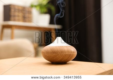 Aroma Oil Diffuser On Wooden Table At Home. Air Freshener