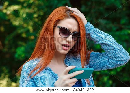 Bad News. Closeup Young Unhappy Frustrated Disappointed Shocked Red Head Woman Girl Lady Hand On Hea