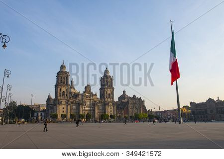 Mexico City - Jan. 15, 2020: Mexico National Flag On Zocalo Constitution Square And Metropolitan Cat