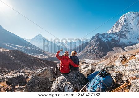 Young Couple Rejoicing On Everest Base Camp Trekking Route Near Dughla 4620m. Backpackers Left Backp