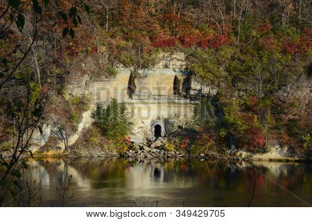 Autumn Foliage Hues Amid Rustic Rocky Edifices Situated Above A Placid Mississippi River, In The Min