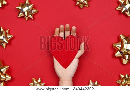 Futuristic Image With A Robot Hand Holding Red Heart On Red Drop With Golden Star Bows. Robotic, Ai,