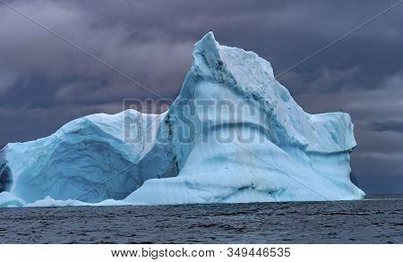 Floating Blue Iceberg Sea Water Charlotte Bay Antarctic Peninsula Antarctica.  Glacier Ice Blue Beca