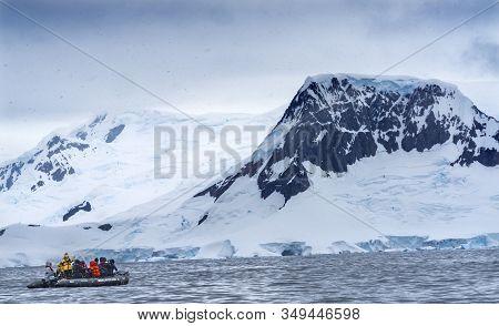 Charlotte Bay, Antarctica - December 26, 2019 Tourist Rubber Boats Snowing Glaciers Snow Mountains C