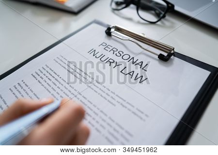 Elevated View Of Paper Of Personal Injury Law