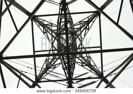 Power Poles Transmission Line, Electricity High Voltage Pole, Electrical Network. Bottom Up View