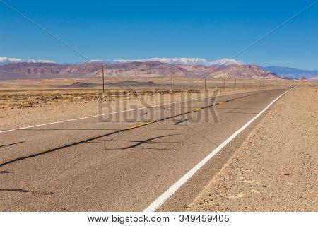 View Of The Wilderness Along The Veterans Memorial Highway In Nevada. Snow-capped Peaks Of The Sierr