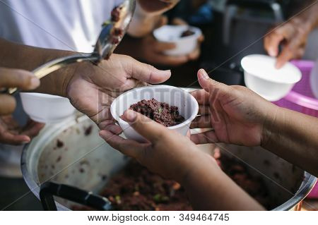 The Concept Of The Beggar Problem On Earth : The Hand Of The Beggars Receives Charity Food From Fell