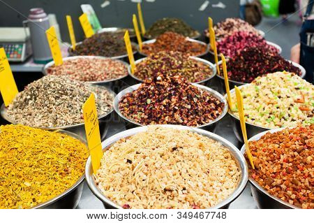 Background From Various Fruit Teas On A Counter At The Mahan Yehuda Market In Jerusalem, Israel. Ori