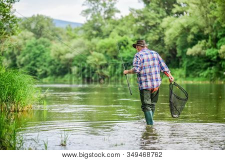 Fishing Freshwater Lake Pond River. Male Leisure. Happiness Is Rod In Your Hand. Senior Man Catching