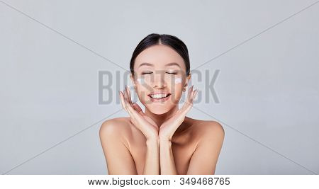 Beauty Face. Woman With Natural Make-up And Portrait Of Healthy Skin. Beautiful Asian Girl Model Tou