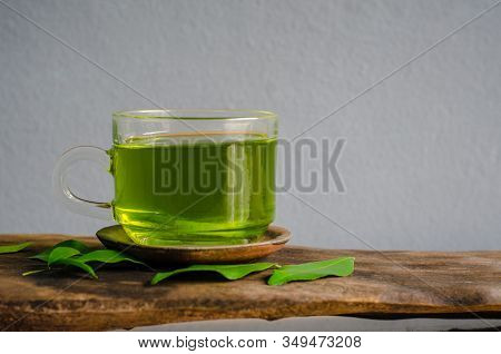 Drink Green Tea With Green Leaf On Grey Background.