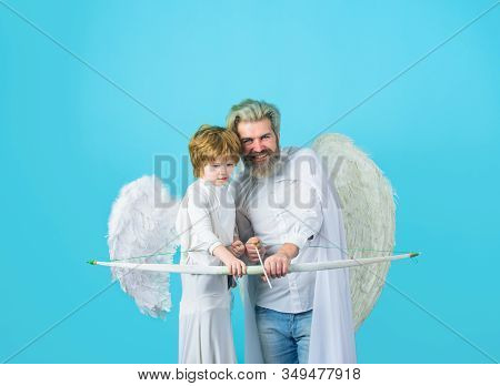 Cute Angel Kid. Happy Father In Angel Costume With Little Son Angel. Father And Son Angels. Father's