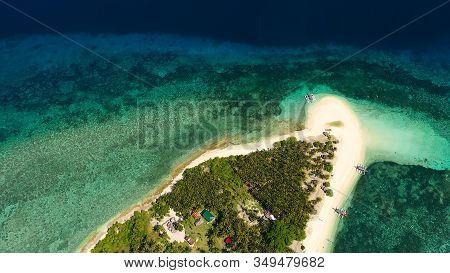 The Island Of White Sand On A Large Atoll, View From Above. Tropical Island With Palm Trees. Seascap