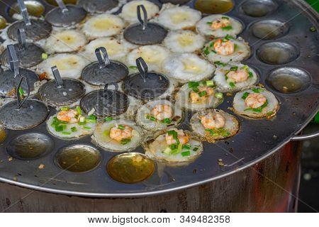 Sizzling Shrimp Pancake On Skillet- Banh Khot, Vietnamese Cuisine