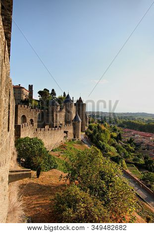 Ancient Castle Of Carcassonne Overlooking The Southern France Countryside. Languedoc, France, Europe