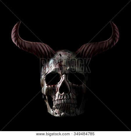 Human skull in blood with horns isolated on black background