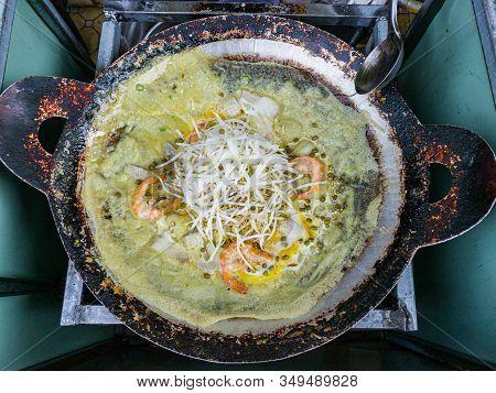 Vietnamese Street Food Banh Xeo- Sizzling Fried Crepe On Pan