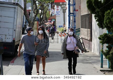 2-5-2020 China Town, Los Angeles CA.  People walk around China Town wearing paper face masks to avoid contacting the Coronavirus. The 2019 Novel Coronavirus (2019-nCoV) is spreading world wide.