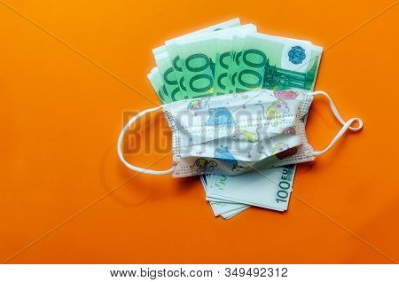Children's Medical Mask Against The Virus On Euro Money, The Concept Of The Price Of Masks, Expensiv