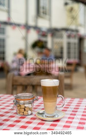Coffee Latte On Garden Table Of English Pub In Midlands, Uk