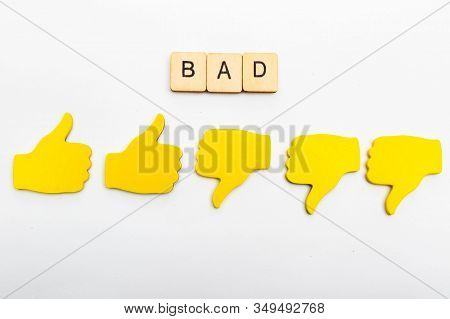 Customer Feedback Concept Showing Five Yellow Hands Isolated On A Plain Background Showing A Sign Re