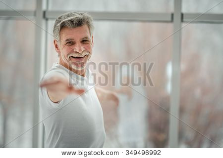 Do Yoga And Enjoy Life.handsome Senior Man Standing In Yoga Position.