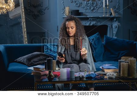 Modern Beautiful Soothsayer Staring At Her Cellphone