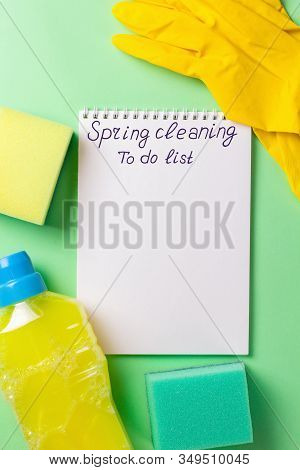 Cleaning Set For Spring Regular Clean Up On Green Background. Blanck For To Do List. Copy Space.
