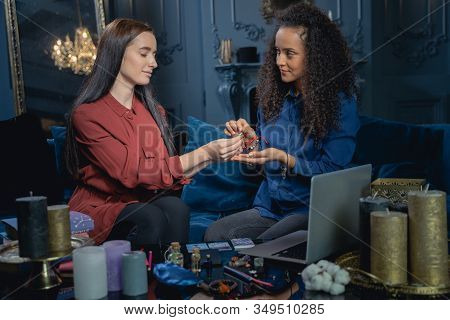 Smiling Modern Soothsayer Staring At Her Client